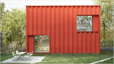 Ein moderner Würfel mit traditioneller roter Holzfassade und großen Fenstern ...